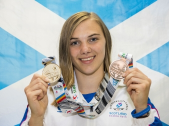 Alisha Rees holds her silver and bronze medals from the Samoa 2015 Youth Games